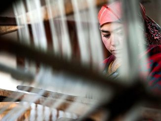 A worker uses a spinning wheel to produce silk in Hotan, Xinjiang Uygur autonomous region, in November.